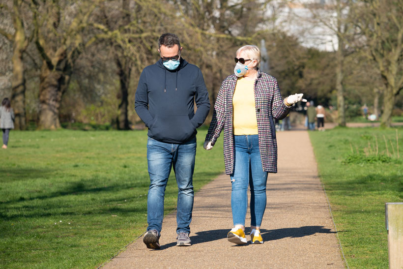Photo of older man and woman walking on a path